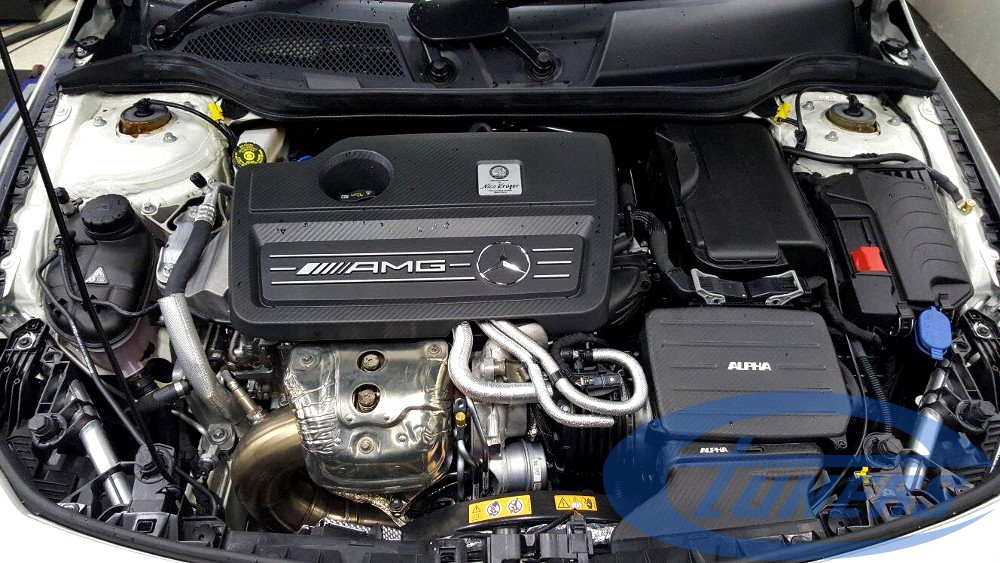 Mercedes CLA45 AMG 2.0T - The Alpha intake kit and upgraded downpipe are visible in the engine bay